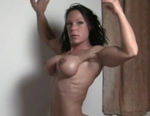 Ripped female bodybuilder Bella wakes up and masturbates