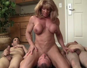 makes them worship her biceps, abs and pecs, suck on her big clit