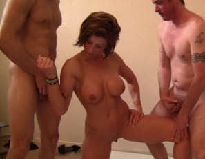 Female muscle porn star Mistress Amazon is masturbating her wet pussy