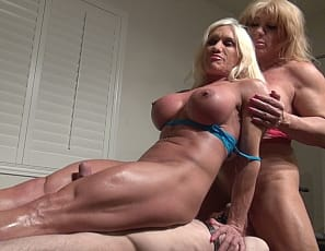 Female bodybuilders, muscle porn stars and fem dommes Ashlee Chambers and Wild Kat lift and carry a lucky slave