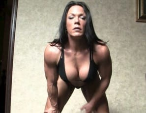 Ripped, vascular naked female bodybuilder Bella's day starts with stretching