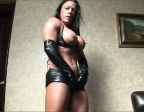 Female bodybuilder Bella's back in black latex gloves and shiny thigh-high boots