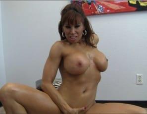 Female muscle porn star Devon Michaels licks her big wet purple toy