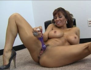 Female muscle porn star Devon Michaels licks her big wet purple toy