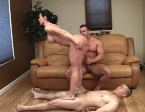 female muscle porn star Kendra Lust makes one man her human carpet and poses for muscle worship