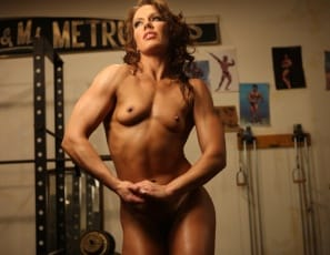 Muscle woman looking at porn